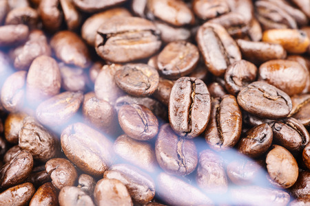 Roaster: Coffee beans from the roaster with the white smoke Stock Photo