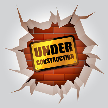 brick work: Under construction sign inside broken wall