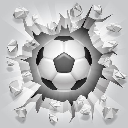 Balón de fútbol y la pared agrietada