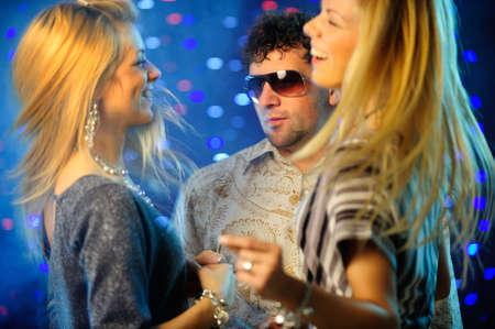 Happy friends clubbing
