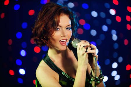 Beautiful female singer on stage