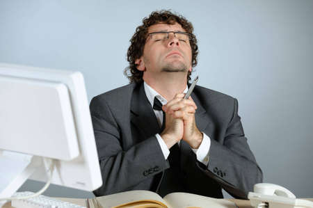 Praying businessman photo