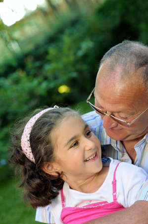 Grandfather and girl outdoors Stock Photo - 4098818