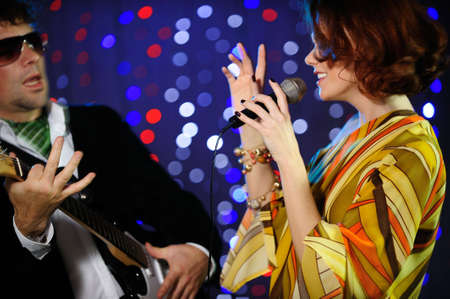 Female singer and male guitar player on stage Stock Photo - 4098800
