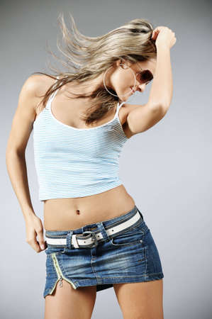 Beautiful blond female dancing Stock Photo