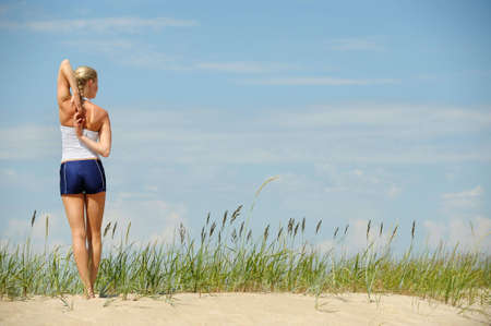Blond female workout on the beach