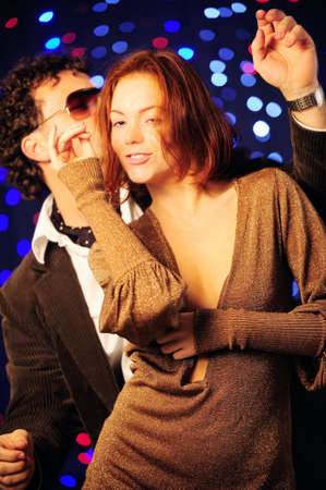 Attractive couple dancing in the club photo