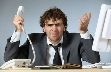 businessman phone: Unhappy businessman