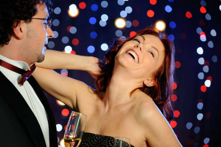 Attractive couple in the nightclub photo