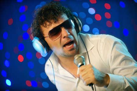 Male DJ on stage photo