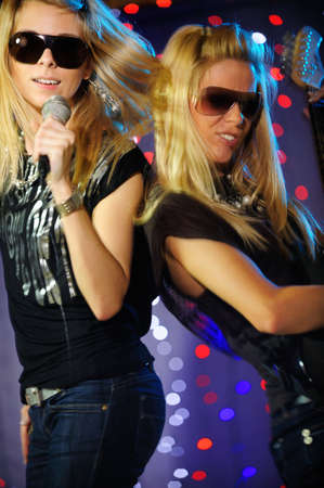 Female singer and guitar player Stock Photo - 4134402