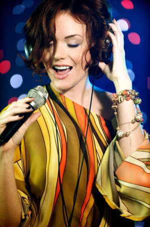Beautiful female singer on stage photo