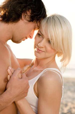 sexy lovers: Happy couple on the beach Stock Photo