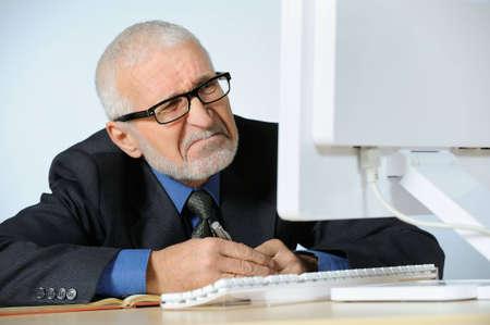 Stressed senior businessman Stock Photo - 4168222