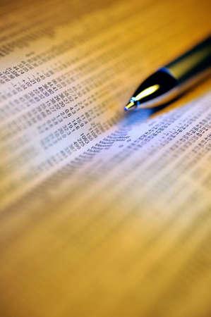 financial newspaper: Pen and financial newspaper
