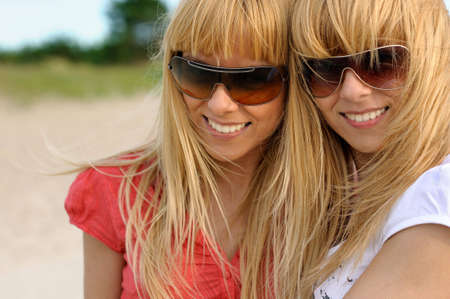 Smiling twins outdoors photo