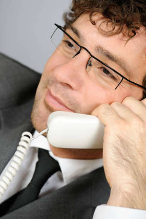 Businessman speaking over telephone Stock Photo - 4215950