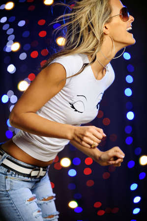 Beautiful female dancing in the club Stock Photo