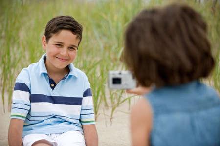 Kids having fun on the beach photo