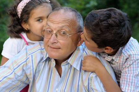 Grandfather and kids outdoors Stock Photo - 4314027