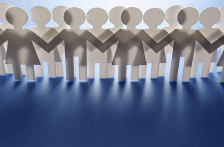 hands joined: Paper people Stock Photo