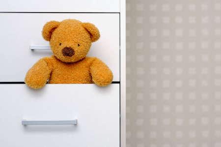 Teddy bear in dresser Stock Photo - 4601432