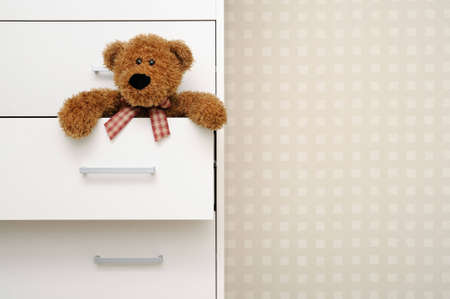 teddy bear in closet Stock Photo