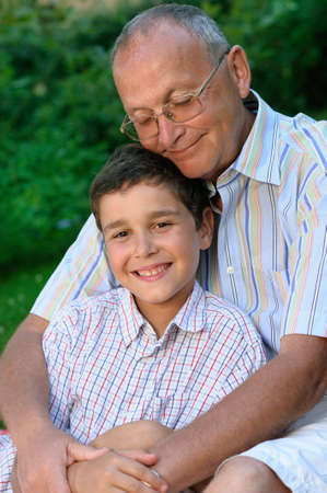Grandfather and kid outdoors Stock Photo - 4673336