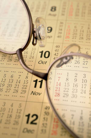 Calender and glasses Stock Photo
