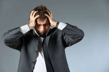 Stressed young businessman Stock Photo - 4726893