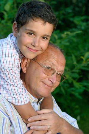 grandson: Happy grandfather and kid outdoors