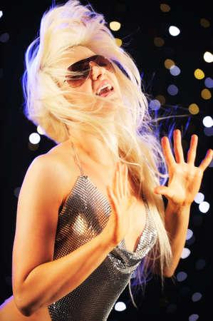 Blond female dancing Stock Photo - 5037149
