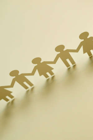 chain of paper cutout people Stock Photo - 5049049