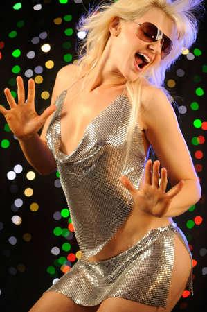 beautiful woman dancing in the nightclub Stock Photo - 5037186