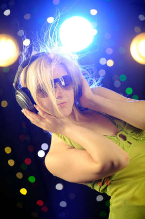 Beautiful blond woman with headphone Stock Photo