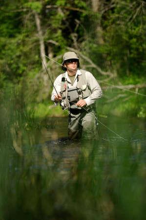 waders: la pesca con mosca Foto de archivo