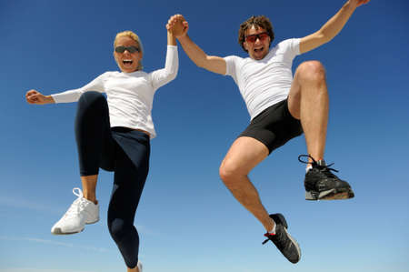 happy couple jumping photo