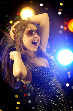 Beautiful woman dancing in the club Stock Photo