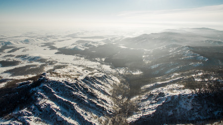 water skiers: Russian Ural mountains in winter. Aerial view of the lake and the endless landscapes