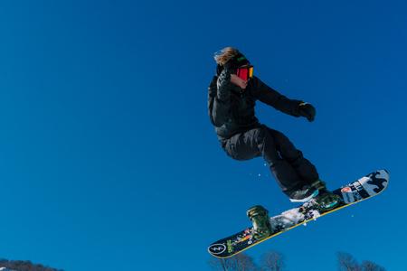 2017 04 Festival NewStarCamp: snowboarder jumps from a high springboard