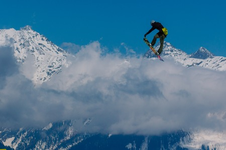 2017 04 Sochi, Russia, Festival NewStarCamp: snowboarder jumps from a high springboard Editorial