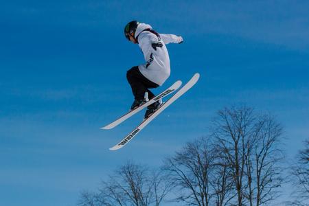 2017 04 Sochi, Russia, Festival NewStarCamp: skier jumps from a high springboard Editorial
