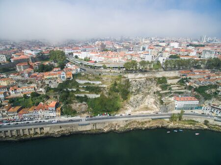 wine road: Panoramic view of the old city of Porto. One flew over the roofs of the houses, a river and a bridge.