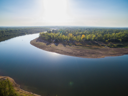 A river in the middle of a forest close to the city. Aerial survey of recreation center Stock Photo