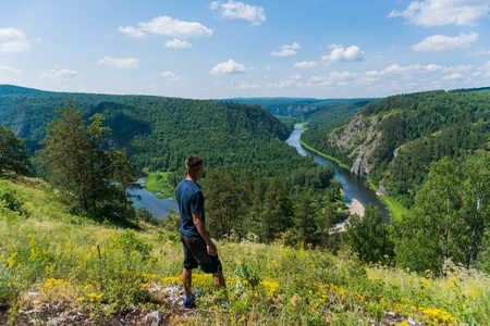 paleolithic: A man looks at the Panoramic view of Shulgan tash nature reserve, Bashkortostan, Russia. Aerial view Stock Photo