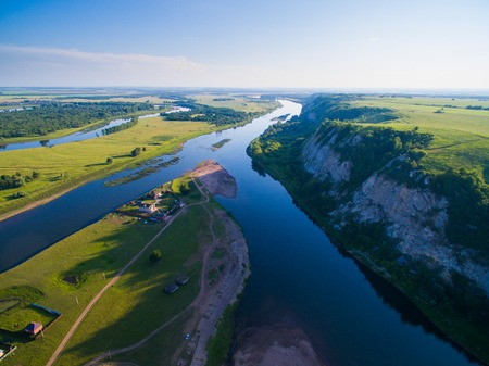 Aerial Russian countryside in a picturesque landscape among mountains and rivers Stock Photo