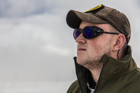 2014 07 Mount Elbrus, Russia: Man looks at the top of Elbrus Editorial