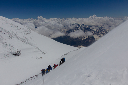 2014 Mount Elbrus, Russia: climbing to the top with a disabled person. Stock Photo