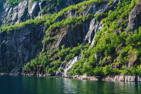 Troll fjord in Norway. Sailing yacht.