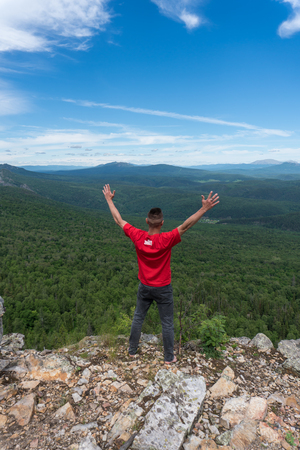 Man stay in a peak in Ural mountains Stock Photo